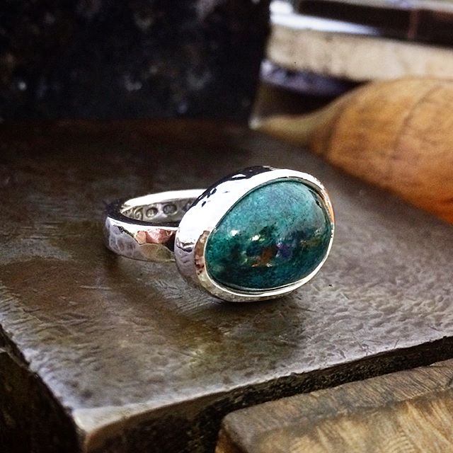 This beautiful deep marine blue-green Chrysocolla variety from Arizona was a little cab I cut myself. It took a very nice shine! Much better in real life! Set in Sterling Silver, beaten and oxidised