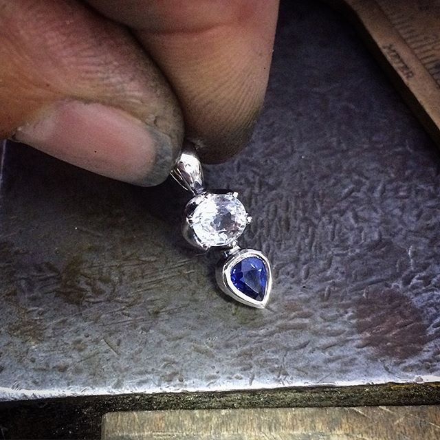I was commissioned to set these two beautiful stones for a Christmas gift for a very special lady. The top one I believe is topaz with the slightest icy blue tinge and the pear shape one a stunning blue sapphire. Together they had fossicked and found the gems in Tasmania and then travelled together and had them cut. Set in sterling silver, the claws are hand filed in a scolloped design and the sapphire is bezel set. A tiny pendant with a lot of heart.