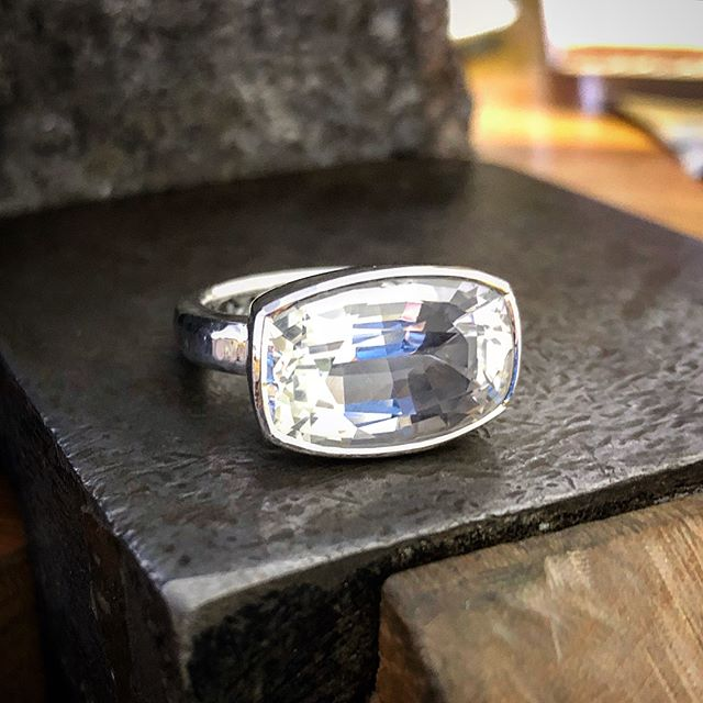 So on Friday I also finished this lovely chunky silver Killiecrankie Diamond/Topaz ring. It's the one with the lovely inclusions a few posts back, I've included those photos here. They didn't show up photos since  after I had the stone. In real life you can only just see them if you look really hard. I think they'll show up more as the ring ages and the silver setting interior dulls a bit. Awesome stone. A bit irregular in shape but I tried to get the setting to look as symmetrical as I could. The setting part is slightly tapered with a high polish and light texture just around the rim of the stone. This ties in well with the tool marked band. Totally silver. I didn't feel the desire to ad any gold to this one. It's beautifully bright, white and pure The stone is completely colourless but you can see a lot of colour reflections in the pics. Enjoy!!