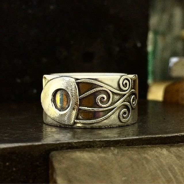 SALE! Some people know that I have had squids in my designs going way back! This ones been hanging around since 2008 I think because of its larger finger size which is V 1/4. Unisex but will more likely fit a man. Sterling silver. Slightly blackened. The squid design is textured and the band is shiny. 12mm wide. I charge way more to make these new but this ones going for $195 plus post. Can be resizedCheers!