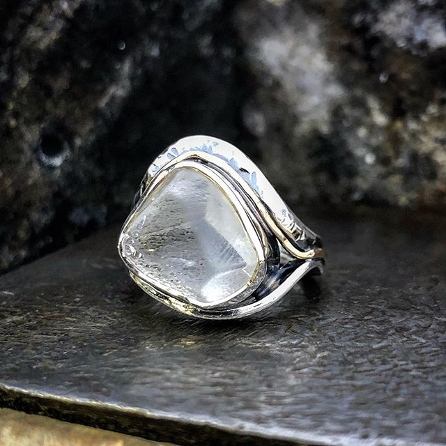 12ct rough Killiecrankie Diamond with the back slightly faceted. I cut and polished the back because that part of it had some unattractive fractures and a dirty look. The surface exhibits the  natural worn facets of the crystal. It's an amazing stone and I might regret not keeping this one for myself🤔 Set in free-formed silver bands with a finer gold wire band. For those who do not know, this is Topaz which comes from The Flinders Island Region of Tasmania. First thought to be actual diamond when they were discovered in the 1800's and named after Mt Killiecrankie
